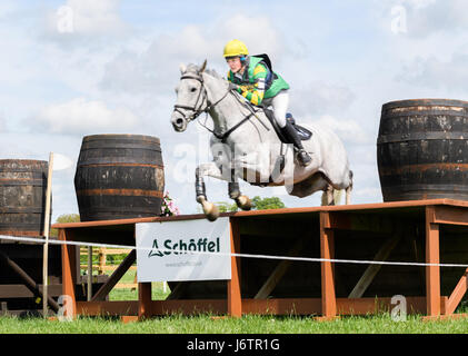 Rockingham Castle, Corby, UK. 21st May, 2017. Holly Needham and her horse Strike a Pose clear the final obstacle - Stock Image