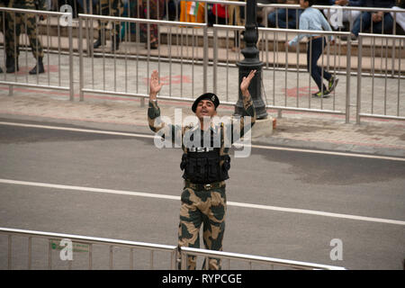 A Border Security Force soldier encourages patriotism at the Attari-Wagah border the day after the Jaish-e-Mohammed terrorist attack in Kashmir. - Stock Image