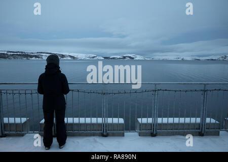 Lone woman, Finnsnes, Norway. - Stock Image