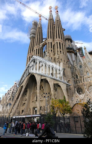Exterior Stone Architectural Detail Of The Basilica of the Sagrada Família In Barcelona Spain A Tower Still Under Construction - Stock Image