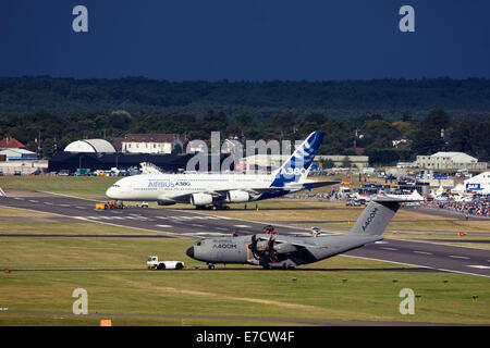 Airbus A380-841 and Airbus A400M Atlas at Farnborough International Airshow 2014 - Stock Image