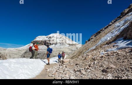 People hiking in Sass Pordoi, Dolomites, Italy, Europe - Stock Image