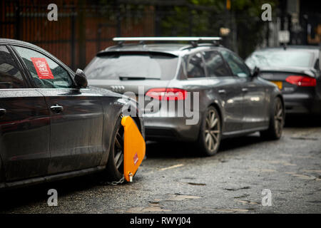 Council issued parking fines and wheel clamped car for on street parking - Stock Image
