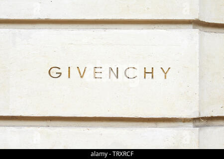 PARIS, FRANCE - JULY 22, 2017: Givenchy, luxury fashion logo carved in stone in avenue George V in Paris, France. - Stock Image