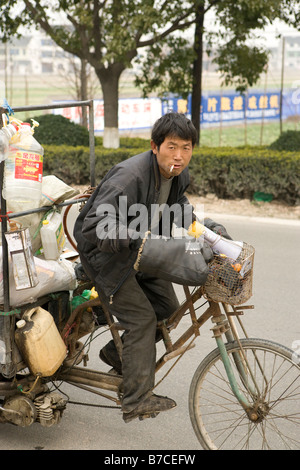 man on bike china changahi - Stock Image