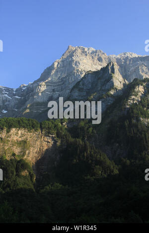 High mountain in Glarus Canton, Switzerland. Mount Glaernisch seen from Lake Kloental. - Stock Image