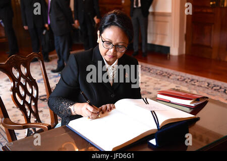 Indonesian Foreign Minister Retno Marsudi signs U.S. Secretary of State Rex Tillerson's guestbook before their - Stock Image