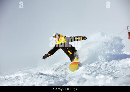 Snowboarder speed riding extreme ski - Stock Image