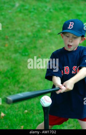 Boy Playing T Ball - Stock Image
