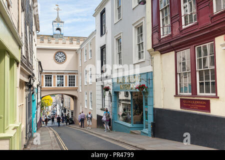 25 May 2018: Totnes, Devon, UK - Shoppers and tourists in the High Street. - Stock Image