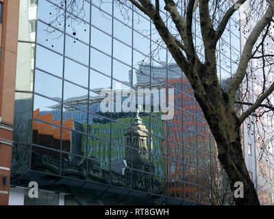 Reflections of the bell tower of the Shaftsbury Theatre and surrounding buildings. - Stock Image