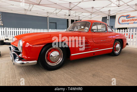 Side view of a beautiful red 1954 Mercedes-Benz  300SL Gullwing  which will be for sale in the 2029 Silverstone Classic Car Auction - Stock Image