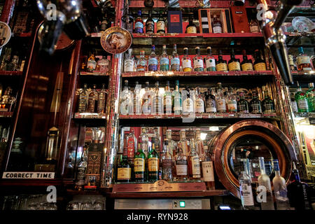 range of irish whiskeys in The Long Hall victorian pub one of the oldest pubs in Dublin republic of Ireland - Stock Image