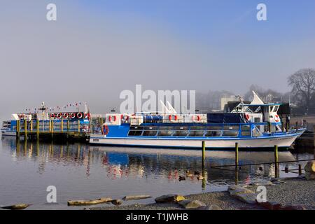 A misty morning at Bowness on Windermere,Lake District,Cumbria,England,UK - Stock Image