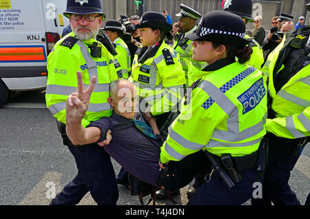 London, April 17th. Environmental campaign group Extinction Rebellion bring traffic to a standstill in central London for the third day running, camping out in several locations around the city, to demand that the Government take emergency action on the climate and ecological crisis.   Waterloo Bridge - after a quiet morning, police move in and start arresting protesters in the afternoon - Stock Image