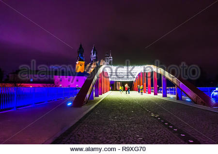 Poznan, Poland - December 26, 2018: The Jordan bridge with decorational lamps during the Christmas holidays by night. - Stock Image