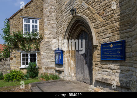 The main door to the church of St Peter in the village of Harrold, Bedfordshire, UK; mostly dating from the 13th century but with later additions. - Stock Image