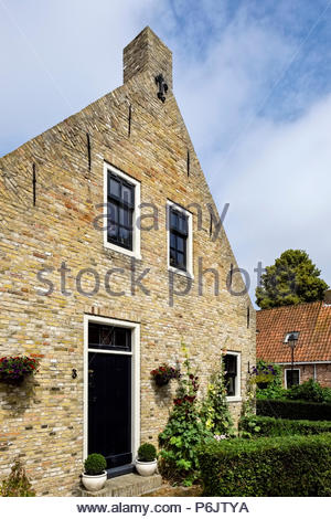 A brick house in the village at Vesting Bourtange, the star-shaped fortress in Groningen Province, The Netherlands - Stock Image