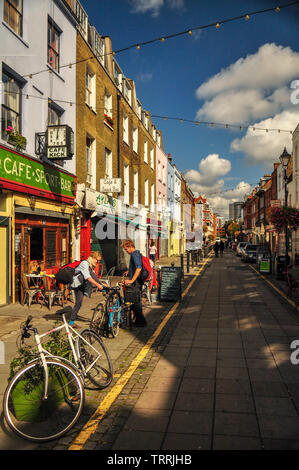 London, England, UK - September 18, 2011: Sun shines on the independent shops and cafes of Exmouth Market in central London. - Stock Image