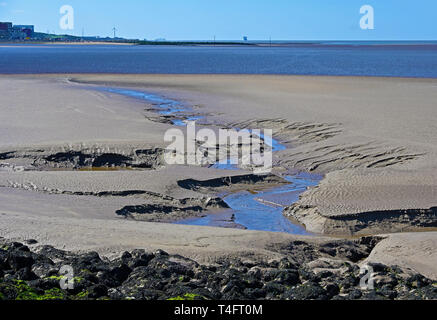 Patterns in the sand at low tide. Morecambe Bay, Lancashire, England, United Kingdom, Europe. - Stock Image
