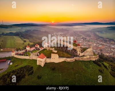 One of the symbols of Romania the Rupea Fortress in Transylvania. Aerial landscape at sunrise - Stock Image