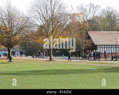 People in Hyde Park. London enjoying the November afternoon sunshine - Stock Image
