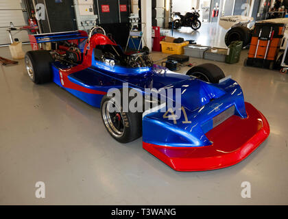 View of David Mercer's Blue and Red, 1978, March 78B Historic Formula 2 Car, in the International Pit Garages, during the 2019 Silverstone Classic Media/Test Day - Stock Image