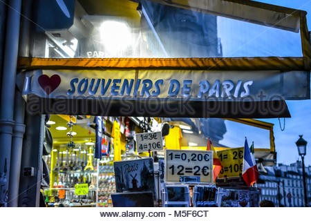 A colorful souvenir and gift shop in the Latin Quarter of Paris France in the early evening. - Stock Image