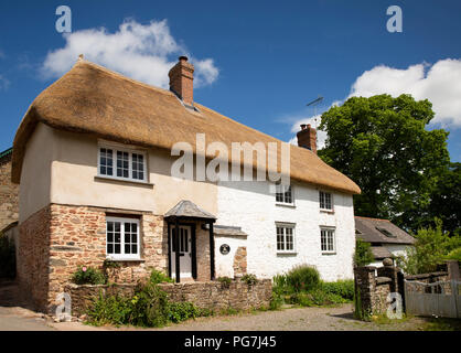UK, England, Devon, Sampford Courtenay, Glebe House, C16th thatched home in centre of village - Stock Image