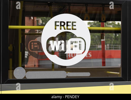 A sign indicating free wifi on the side window of a bus Preston Lancashire June 2018 - Stock Image