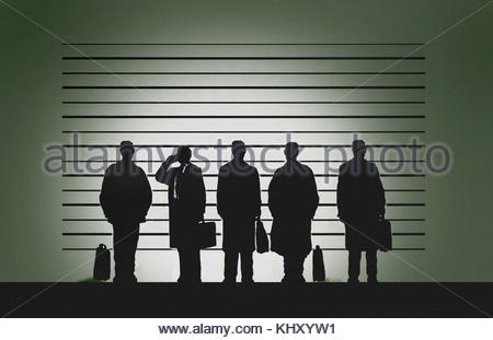 Businessman on phone in police line-up - Stock Image