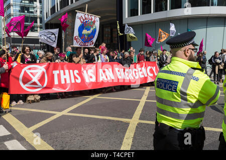 Climate Change protestors with Extinction Rebellion block Oxford Street and simultaneously stop traffic across central London including Marble Arch, Piccadilly Circus, Waterloo Bridge and roads around Parliament Square, on 15th April 2019, in London, England. - Stock Image