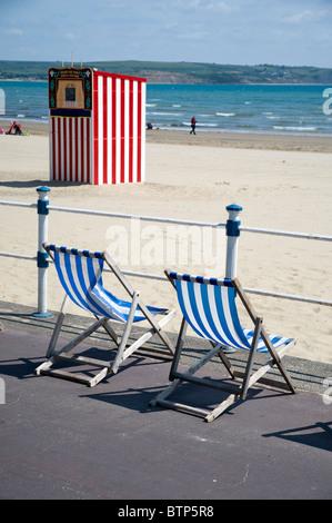 Deckchairs on Weymouth Beach, Dorset, UK. - Stock Image