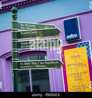 Old Street Signs in Irish and English in Ennistymon in County Clare in Ireland - Stock Image
