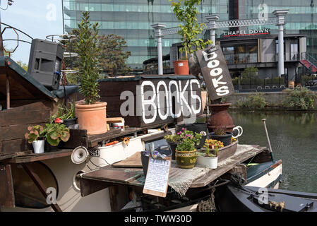 Word on the Water, books signs with planters, the London Book Barge, bookshop on Regent's Canal Kings Cross London England Britain UK - Stock Image