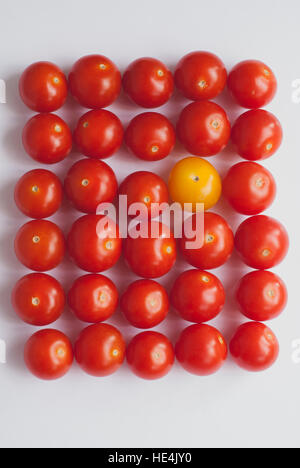 Red and yellow grape tomatoes on a white background - Stock Image