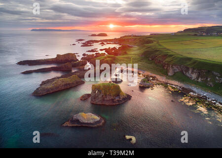 Whitepark Bay where man first settled in Ireland, surrounded by ancient dunes and burial mounds. Folklore tells of the woolly mammoth in the region. - Stock Image