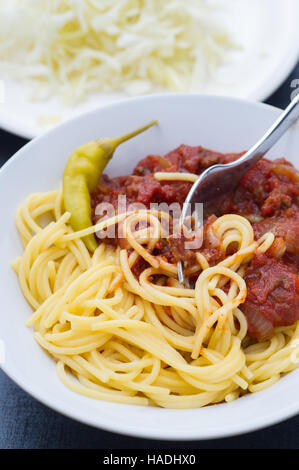 Homemade meat sauce served with pasta, feferoni. - Stock Image