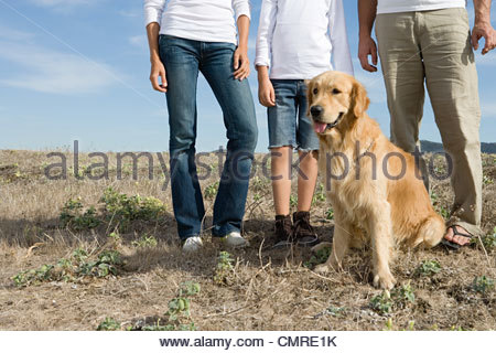 Family with their dog - Stock Image