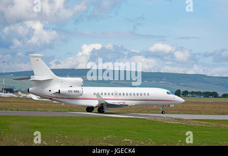 The Danish Lego toy company private Dassault Falcon 8X business jet prepares to depart Inverness Dalcross airport - Stock Image