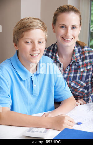 Portrait Of Female Home Tutor Helping Boy With Studies - Stock Image