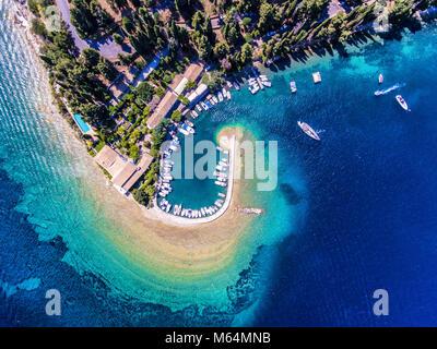 Kouloura old fishing village and beach. Corfu (Kerkyra) Island, Greece, Europe. Fishing boats and clear blue waters. - Stock Image