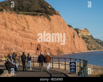 Sidmouth, Devon. 2nd Nov 2018. UK Weather: People take a look at the famous red cliffs at Sidmouth on a glorious afternoon in November. Photo Central/Alamy Live News - Stock Image