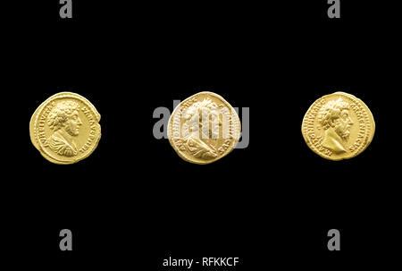 Merida, Spain - August 25th, 2018: 3 Gold coins of Marcus Aurelius Roman Emperor at MNAR Museum, Merida, Spain - Stock Image