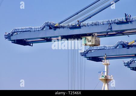 Working cranes at the Port of Felixstowe, Suffolk, UK. 29th March 2019. - Stock Image