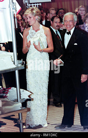 Diana, Princess of Wales views a display with fashion designer Ralph Lauren, right, during a charity gala fundraising event for the Nina Hyde Center for Breast Cancer Research September 24, 1996 in Washington, DC. - Stock Image