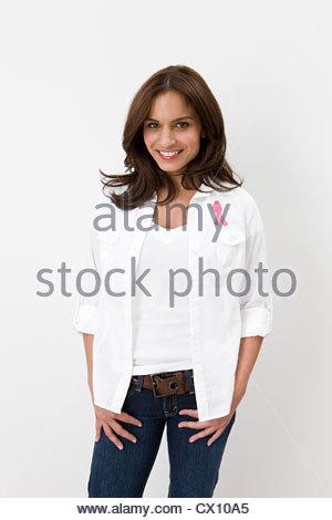 Woman wearing breast cancer awareness ribbon - Stock Image