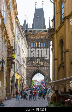 Prague Old Town, view of Karlova street and the eastern side of Stare Mesto Bridge Tower with its celebrated golden statues, Prague,Praha, Czech Rep. - Stock Image