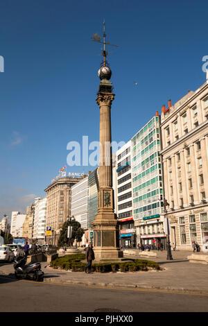 Spain, Galicia, A Coruna, Avenida Marina, historic column monument opposite new glazed waterfront buildings - Stock Image