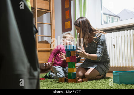 Mother playing with her son with toy building blocks, Munich, Germany - Stock Image
